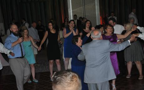 Bride and groom share a dance with their wedding guests