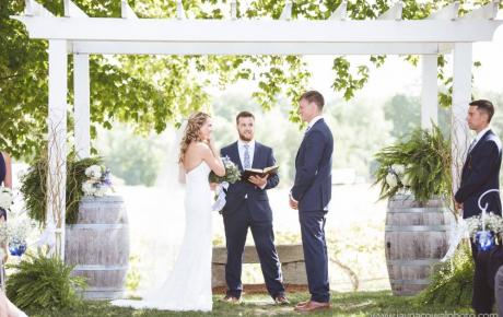 Ceremony under arbor at Flag Hill Winery. Photo by Jayna Cowal Photography - Ceremony Music Provided by Audio Events
