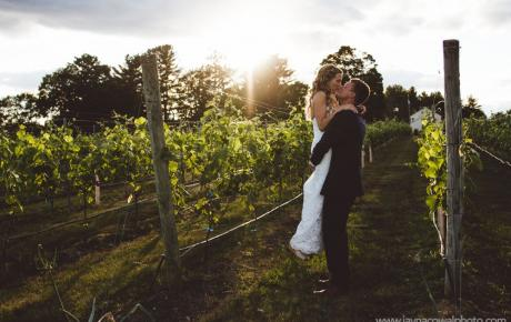 Emily and Matt hugging in the vineyard at Flag Hill Winery. Photo by Jayna Cowal Photography